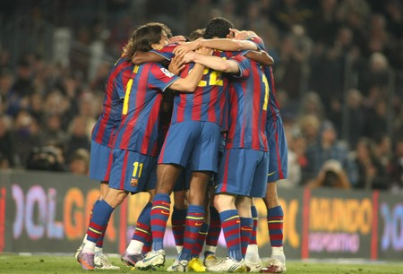 Players group of FC Barcelona celebrate goal during a Spanish League match between FC Barcelona and Athletic Bilbao at the Nou Camp Stadium on April 3, 2010 in Barcelona, Spain Stock Photo - 9684211