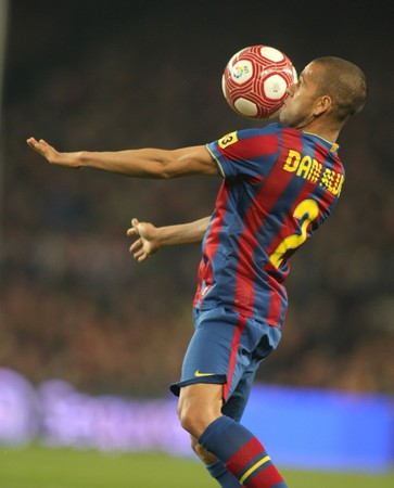 dani: Dani Alves of FC Barcelona in action during a Spanish League match between FC Barcelona and Valencia at the Nou Camp Stadium on March 14, 2010 in Barcelona, Spain