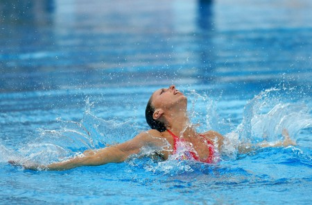 Spanish olympic medalist Gemma Mengual swims a solo exercise during the Espana Sincro meeting in Barcelona Picornell Swimpool, June 14, 2007 in Barcelona, Spain. Editorial