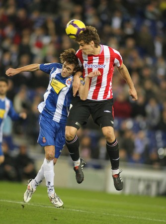 midfielder: Baena(L) of Espanyol fight with Llorente(R) during a Spanish League match between Espanyol and Athletic Bilbao at the Estadi Cornella on January 30, 2010 in Barcelona, Spain Editorial