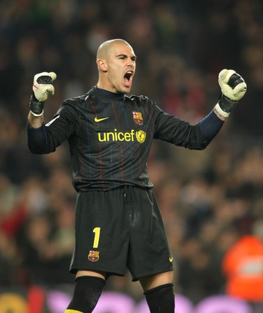Victor Valdes of Barcelona celebrating a gol during a Spanish League match between FC Barcelona and Malaga at the Nou Camp Stadium on February 27, 2010 in Barcelona, Spain