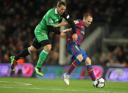 iniesta: Xisco (L) of Santander and Iniesta (R) of Barcelona during Spanish league match between Barcelona and Santander at the Nou Camp Stadium on February 20, 2010 in Barcelona, Spain.