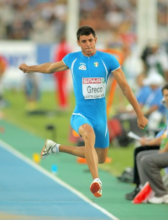 daniele: Daniele Greco of Italy competes on the men triple jump final during the 20th European Athletics Championships at the Olympic Stadium on July 27, 2010 in Barcelona, Spain Editorial