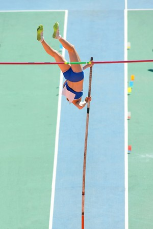 successfull: An athlete attempts successfull a pole vault Stock Photo