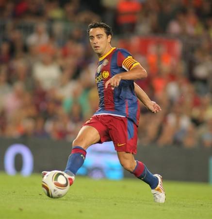midfielder: Xavi Hernandez of Barcelona during Supercup match between Barcelona vs Sevilla at the New Camp Stadium in Barcelona on August 21, 2010 Editorial