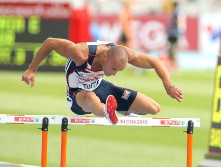 Andy Turner of Great Britain competes on the 110m Hurdles event during the 20th European Athletics Championships at the Olympic Stadium on July 29, 2010 in Barcelona, Spain