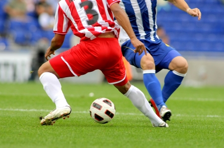 Soccer player legs in action photo