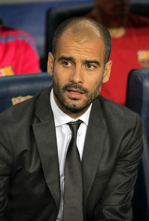 champion of spain: Josep Guardiola of Barcelona during spanish league match between FC Barcelona and Sporting Gijon at Nou Camp Stadium in Barcelona, Spain. September 22, 2010