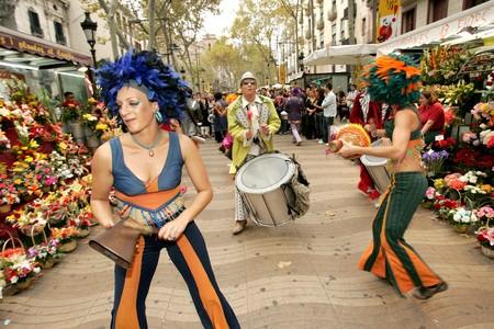 troop: Dance troop in full swing Sandunga performing his show at Las Ramblas during a Festival City on September 21, 2008 in Barcelona, Spain