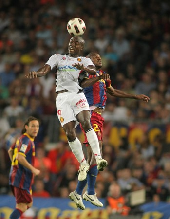 cameroonian: Pierre Webo of Mallorca in action during spanish league match between FC Barcelona and RCD Mallorca at Nou Camp Stadium in Barcelona, Spain. October 3, 2010 Editorial