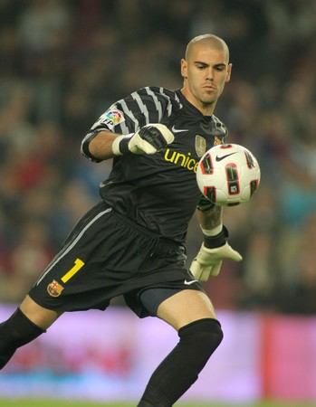 victor: Victor Valdes of FC Barcelona in action during spanish league match between FC Barcelona and Valencia CF at Nou Camp Stadium in Barcelona, Spain. October 16, 2010 Editorial