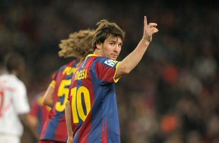 leo messi: Leo Messi of FC Barcelona celebrates goal during spanish league match between FC Barcelona and Sevilla FC at Nou Camp Stadium on October 30, 2010 in Barcelona, Spain