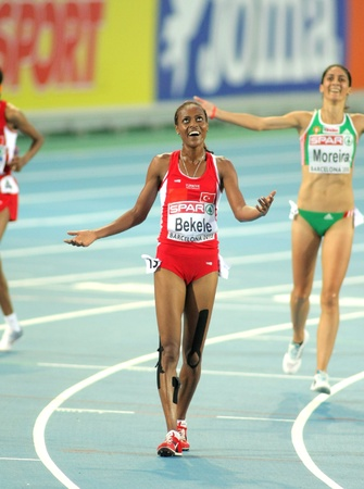 Alemitu Bekele of Turkey celebrates victory on 5000m women of the 20th European Athletics Championships at the Olympic Stadium on August 1, 2010 in Barcelona, Spain Stock Photo - 8491432