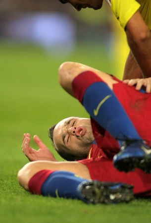 Iniesta of FC Barcelona injured during spanish league match between FC Barcelona and Villarreal CF at Nou Camp Stadium on November 13, 2010 in Barcelona, Spain