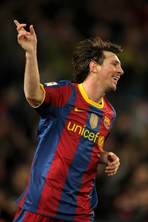 Leo Messi of Barcelona celebrates goal during a Spanish League match between FC Barcelona and Real Sociedad at the Nou Camp Stadium on December 12, 2010 in Barcelona, Spain