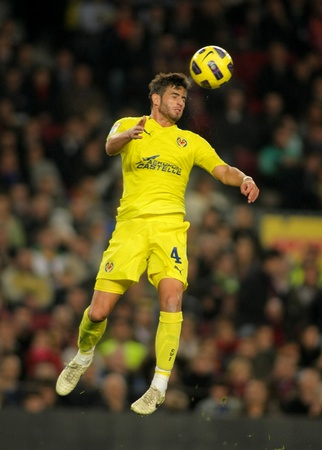 cf: Mateo Musacchio of Villarreal CF in action during a Spanish League match between FC Barcelona and Villarreal CF at the Nou Camp Stadium on November 13, 2010 in Barcelona, Spain Editorial