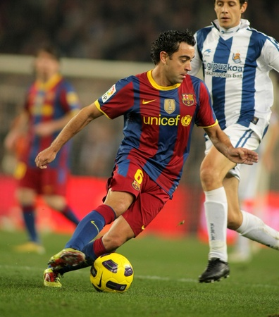xavi: Xavi Hernandez of Barcelona in action during a Spanish League match between FC Barcelona and Real Sociedad at the Nou Camp Stadium on December 12, 2010 in Barcelona, Spain