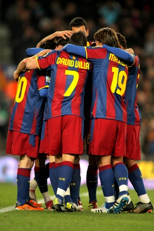Players group of FC Barcelona celebrate goal during a Spanish League match between FC Barcelona and Racing at the Nou Camp Stadium on January 22, 2011 in Barcelona, Spain Stock Photo - 8807668