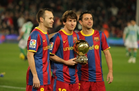 Iniesta, Messi and Xavi of Barcelona with golden ball before a Spanish Cup match between FC Barcelona and Real Betis at the Nou Camp Stadium on January 12, 2011 in Barcelona, Spain