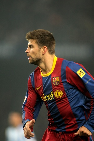 barsa: Gerard Pique of Barcelona during the match between FC Barcelona and Malaga CF at the Nou Camp Stadium on January 16, 2011 in Barcelona, Spain Editorial
