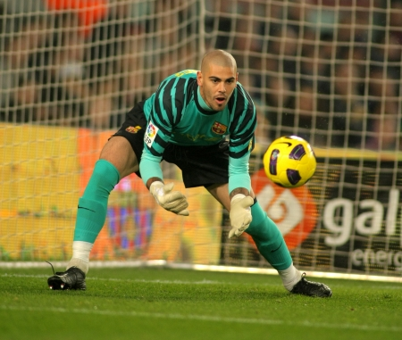 champion of spain: Victor Valdes of Barcelona in action during the match between FC Barcelona and Real Betis at the Nou Camp Stadium on January 12, 2011 in Barcelona, Spain