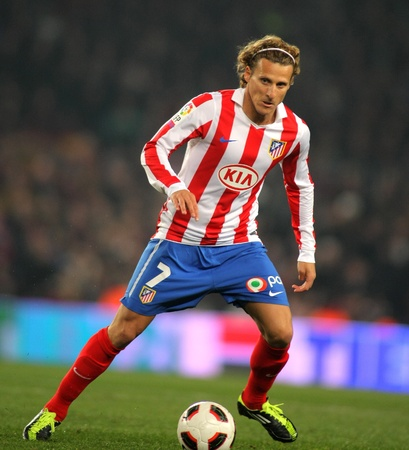 champion of spain: Diego Forlan of Atletico Madrid during the match between FC Barcelona and Atletico Madrid at the Nou Camp Stadium on February 5, 2011 in Barcelona, Spain