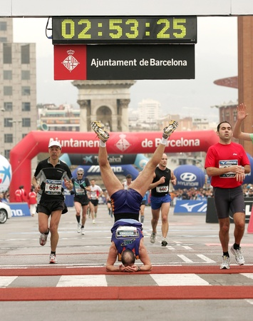 Athlete celebrating his record in acrobatic way at finish during Barcelona Marathon on March 1, 2009 in Barcelona, Spain