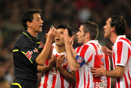 Atletico Madrid players discuss with the referee Turienzo Alvarez during the match between FC Barcelona and Atletico Madrid at the Nou Camp Stadium on February 5, 2011 in Barcelona, Spain Stock Photo - 8932667