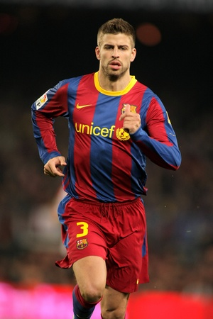 Pique of Barcelona during the match between FC Barcelona and Athletic de Bilbao at the Nou Camp Stadium on February 20, 2011 in Barcelona, Spain