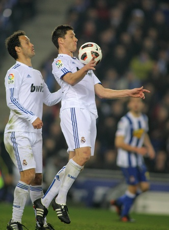 xavi: Xabi Alonso of Real Madrid during a spanish league match between Espanyol and Real Madrid at the Estadi Cornella on February 13, 2011 in Barcelona, Spain