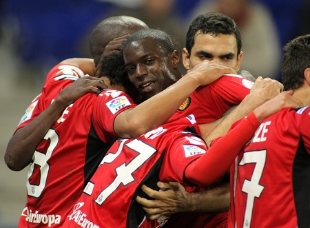 winger: Michael Pereira of Mallorca celebrates goal with others players during the match between Espanyol and Real  Mallorca at the Estadi Cornella on March 1, 2010 in Barcelona, Spain