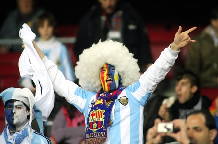 supporter: Argentinian supporter celebrate a goal during the friendly match between Catalonia vs Argentina at Camp Nou Stadium Dec. 22, 2009 in Barcelona