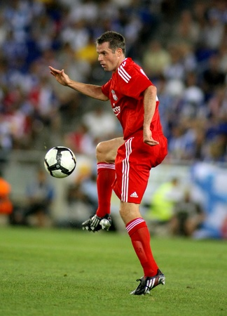 champions league: Jamie Carragher of Liverpool FC in action during a friendly match against RCD Espanyol at the Estadi Cornella-El Prat on August 2, 2009 in Barcelona, Spain