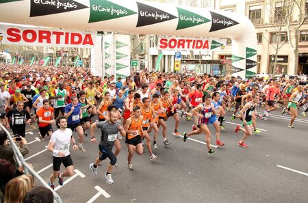 Runners on start of Cursa de El Corte Ingles, the second most popular race in the world, on  Barcelona streets on April 3, 2011 in Barcelona, Spain