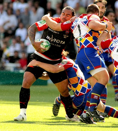 Toulons's Christian Loamanu is tackled by Perpignan's player during the Heineken European Cup quarter-final match USAP Perpignan against RC Toulon at the Olympic Stadium in Barcelona, on April 9, 2011 Stock Photo - 9472220