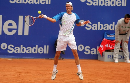 ignacio: Argentinian tennis player Juan Ignacio Chela  in action during the first round match of the Barcelona tennis tournament Conde de Godo on April 19, 2011 in Barcelona
