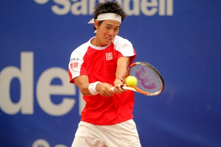 conde: Japanese Kei Nishikori in action during the first round match of the Barcelona tennis tournament Conde de Godo on April 19, 2011 in Barcelona Editorial