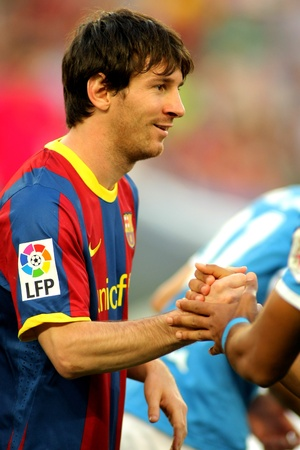 Leo Messi of Barcelona shake hands before  the match between FC Barcelona and UD Almeria at the Nou Camp Stadium on April 9, 2011 in Barcelona, Spain Stock Photo - 9475273