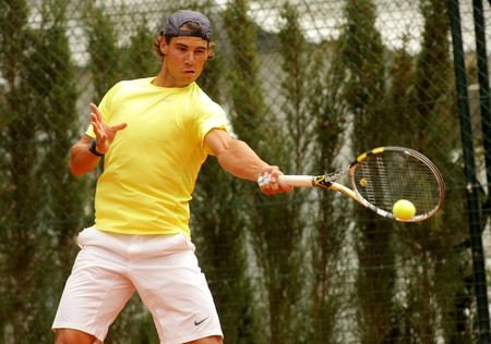 Spanish tennis player Rafa Nadal training the day before of his debut during the Barcelona tennis tournament Conde de Godo on April 19, 2011 in Barcelona
