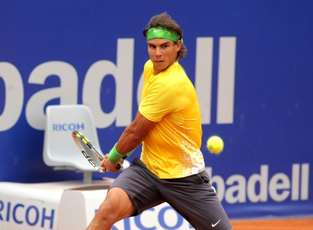Spanish tennis player Rafael Nadal in action during his match against Gimeno-Traver of   Barcelona tennis tournament Conde de Godo on April 20, 2011 in Barcelona
