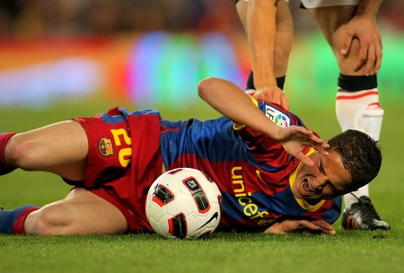 winger: Ibrahim Afellay of Barcelona injured during the match between FC Barcelona and Osasuna at the Nou Camp Stadium on April 23, 2011 in Barcelona, Spain Editorial