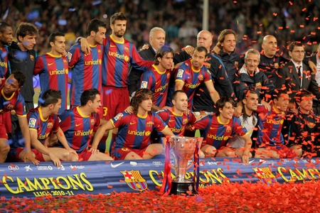 champion of spain: FC Barcelonas players celebrate La Liga trophy after the match between Barcelona and Deportivo La Coruna at Camp Nou Stadium on May 15, 2011 in Barcelona, Spain