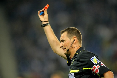 Referee Clos Gomez indicates kick off after he blows the whistle during a Spanish League match between Espanyol and Valencia at the Estadi Cornella on May 11, 2011 in Barcelona, Spain