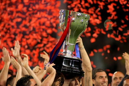 FC Barcelona's players hold up La Liga trophy after the match between Barcelona and Deportivo La Coruna at Camp Nou Stadium on May 15, 2011 in Barcelona, Spain Stock Photo - 9743747