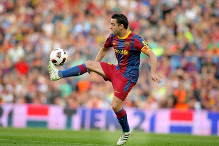 champion of spain: Xavi Hernandez of Barcelona during the match between FC Barcelona and RCD Espanyol at the Nou Camp Stadium on May 8, 2011 in Barcelona, Spain Editorial