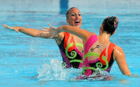 womankind: Greeks synchro swimmers Despoina Solomou and Neftaria Ramnioti in a Duet exercise during the Espana Sincro meeting in Barcelona Picornell Swimpool, June 18, 2011 in Barcelona, Spain