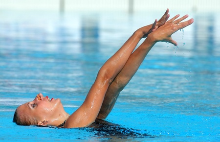 Russian sports competition swimmer Liubov Leshchik swims a solo exercise during the Espana Sincro meeting in Barcelona Picornell Swimpool, June 19, 2011 in Barcelona, Spain Stock Photo - 9880718