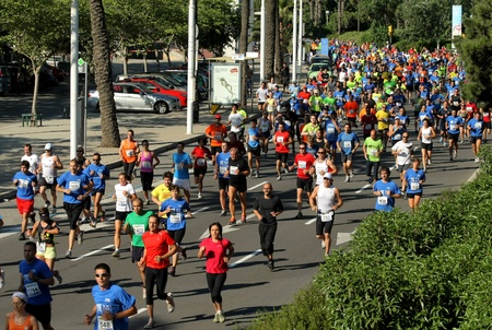 Runners on the popular race of the Olympic Village that take place through the streets of Barcelona on June 26, 2011 in Barcelona, Spain