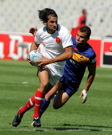 Paul Albadalejo of France drives the ball during the match of Rugby7 European Champìonship between France and Romania at the Olympic Stadium in Barcelona, on July 9, 2011