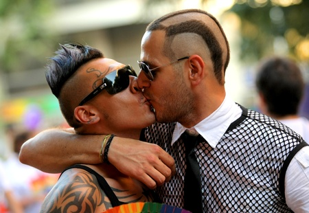 Two young men kissing during the annual Barcelona Gay and Lesbian Pride Festival through the city streets, June 26, 2011 in Barcelona, Spain Stock Photo - 10005954